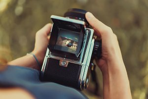 Girl using vintage film camera