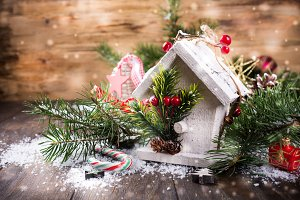 Christmas composition with white wooden house,