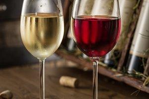 Wine glasses on the wooden shelf.