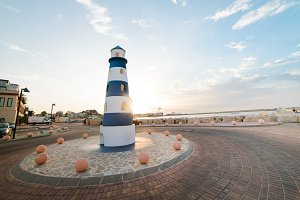Blue and white lighthouse at sunset in Denia