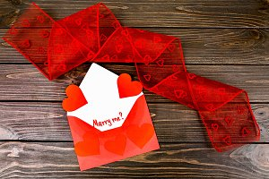 Envelope with hearts and red tape