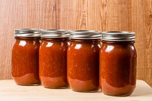 Four jars of fresh tomato sauce