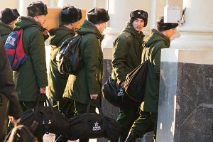 Moscow, December 2016 - The soldiers recruits in green uniforms with boxes go and look