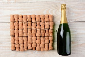 Bottle of Champagne and Corks