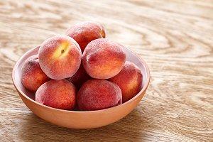 Ripe peaches in bowl