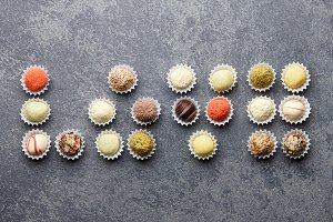 Truffle chocolates arranged in love