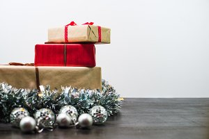 Christmas gifts on a table with white background