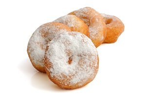 Fried donuts in powdered sugar
