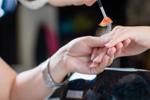 Manicure procedure with the glittering nails