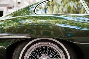 Wheel of a green vintage car