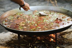 Cooking of a raditional spanish dish paella