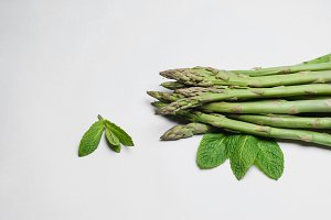 Closeup fresh asparagus isolated on white background