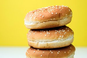 The burger buns on white and yellow background