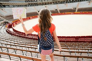 Girl tourist at Plaza del Toros, a bullfighting arena