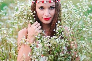 Cute girl with a wreath on head