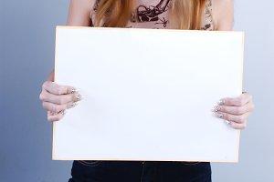 Woman takes placard