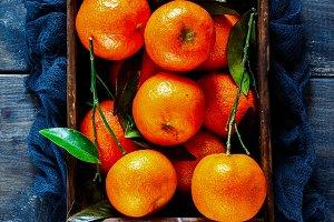 Wooden box of tangerines