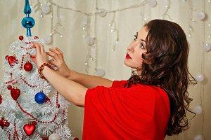 Girl decorates Christmas tree