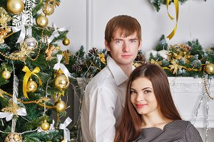 Husband and wife near Christmas tree