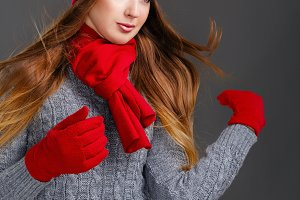 Girl in knit sweaters, gloves, hat