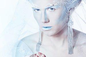 Snow queen with heart in hands