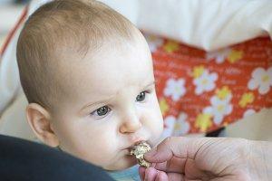Baby eats alone.