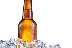 Cold bottle of beer in the ice cubes