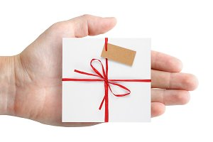 Gift box with tag in hand