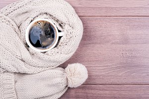 Coffee cup, knitting scarf and hat