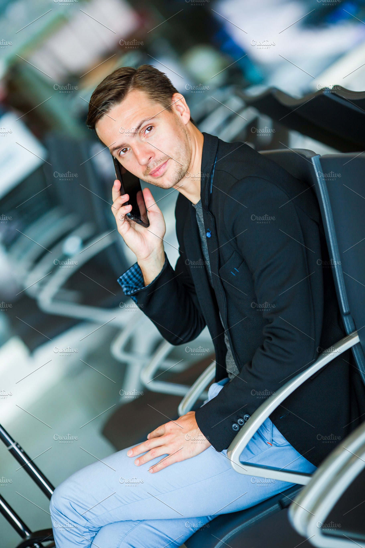 1bb8615ef4e Urban business man talking on smart phone traveling inside in ...