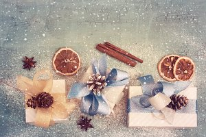 Vintage Holiday background with New Year's gifts, tinted.