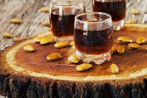 Italian liqueur Amaretto in cups, selective focus