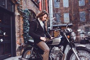man on vintage custom motorcycle