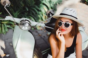 girl on  vintage scooter