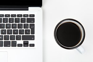 Top view of laptop with coffee