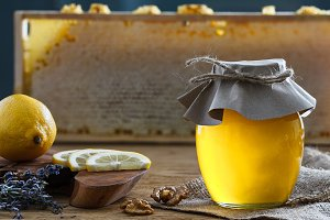 Honey jar with lemon pieces and lavender