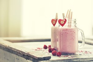 Love concept with smoothie in jars
