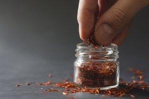Hand picking saffron
