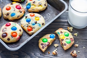 Shortbread cookies with multi-colored candy and chocolate chips on metal tray, horizontal