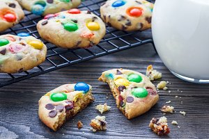 Shortbread cookies with multi-colored candy and chocolate chips on cooling rack, horizontal