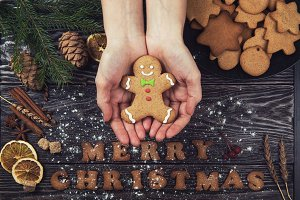 Woman hands keep ginger cookies