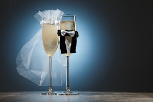 Two cooled glasses of champagne decorated for married couple