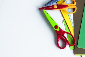 Curly scissors and colored paper
