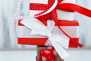 Many gift boxes with red ribbon