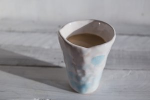 white clay cup with cocoa