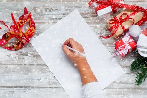 Girl hands writing letter Santa