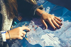 girl with map in travel
