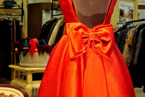 manikin in red with bow