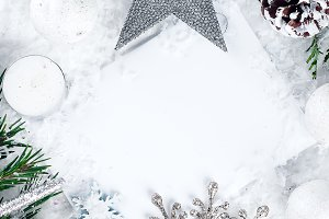 Christmas card with decorated fir tree on snow.