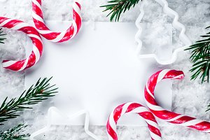 Clear paper laying with candy cane.